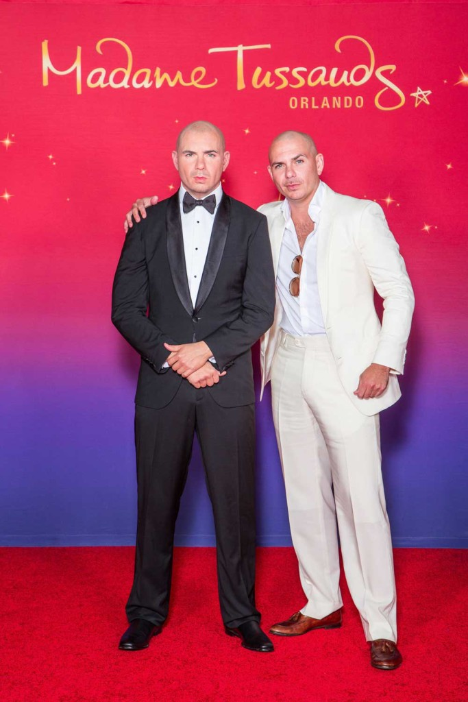 Pitbull (right) with his wax figure COURTESY OF MADAME TUSSAUDS ORLANDO